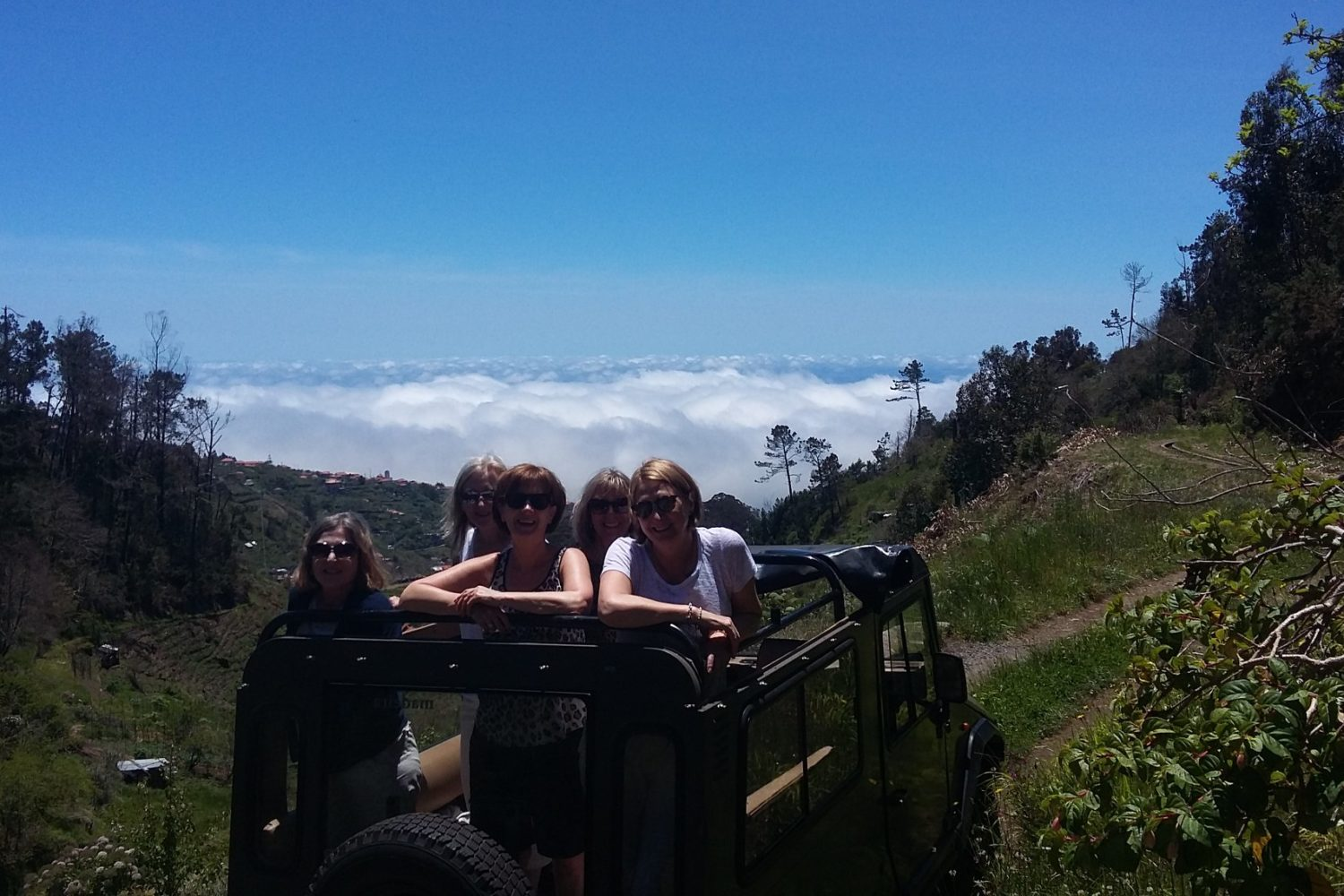 above the clowds in Jardim da Serra in our open top Jeep